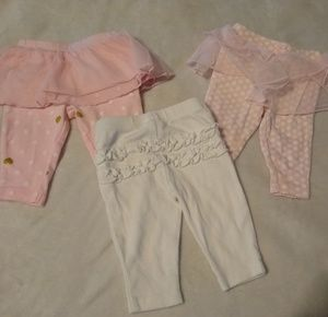 3 pairs of pink and white newborn leggings